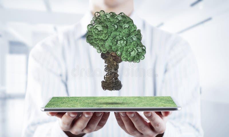Eco esverdeia o conceito do ambiente apresentado pela ?rvore como o mecanismo ou o motor de trabalho imagens de stock