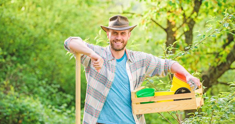 Eco farm worker. Harvest. sexy farmer hold shovel and box with pot. farming and agriculture. I love to work with plant stock photo