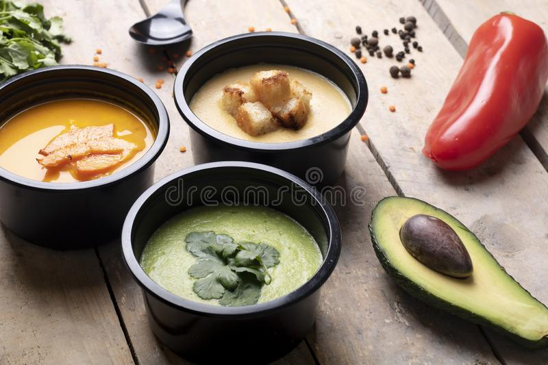 Eco food boxes with proper nutrition, balanced diet to lose weight. Vegan lunches in round food boxes, spices on spoons and micro greens around stock image