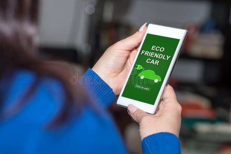 Eco friendly car concept on a smartphone. Smartphone screen displaying an eco friendly car concept royalty free stock image