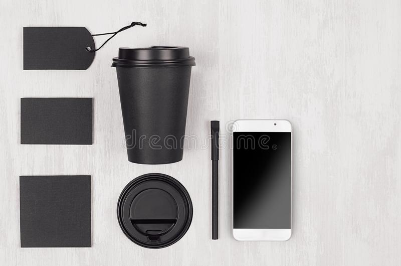 Eco friendly coffee template for design, advertising and branding - black paper cup, blank screen phone, label, card, cap, sugar. stock photos