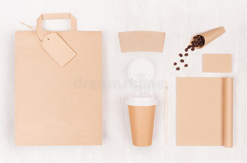 Eco friendly coffee template for design, advertising and branding - brown paper cup, blank bag, notebook, label, coffee beans. stock photo