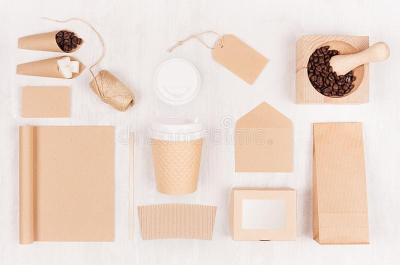 Eco friendly coffee template for design, advertising and branding - brown paper cup, blank notebook, box, sugar, card, beans. stock photography