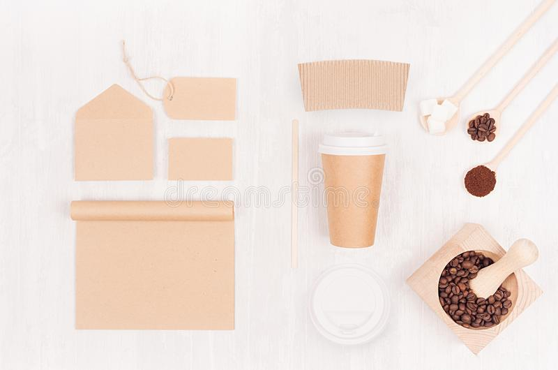 Eco friendly coffee template for design, advertising and branding - brown paper cup, blank notebook, label, card, mortar. stock photo