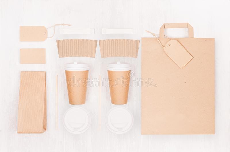 Eco friendly coffee template for design, advertising and branding - two brown paper cups and blank bag, packet, label, card, cap. stock photos