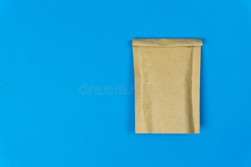 Eco friendly concept. A empty paper bag on blue paper background and space. Environmental concept stock image