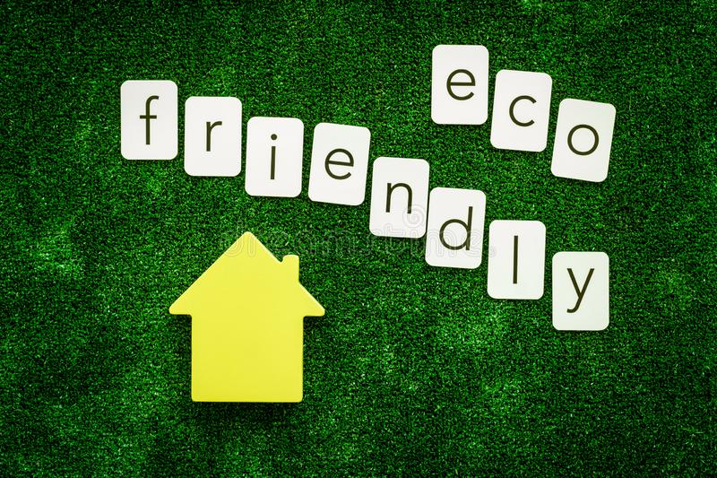 Eco friendly copy and house for ecological concept on green texture background top view.  royalty free stock photo