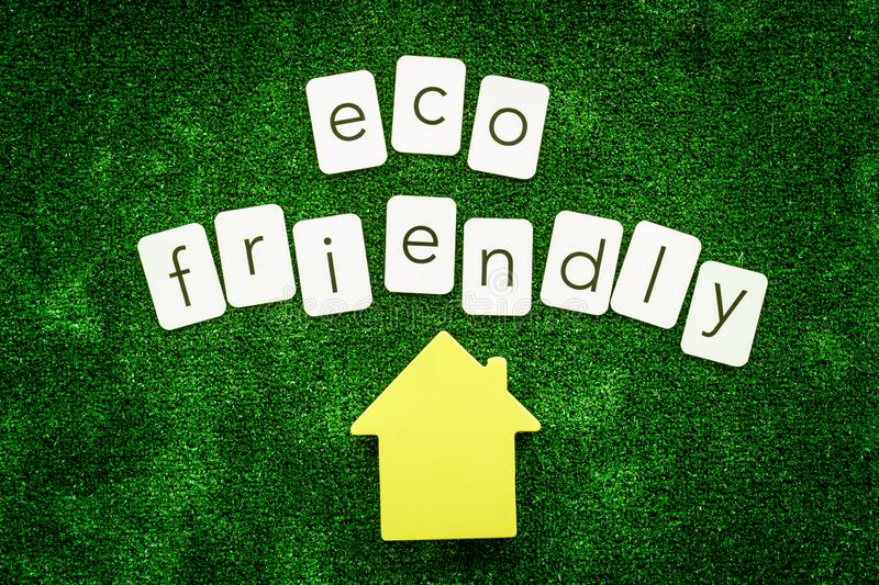 Eco friendly copy and house for ecological concept on green texture background top view.  stock images