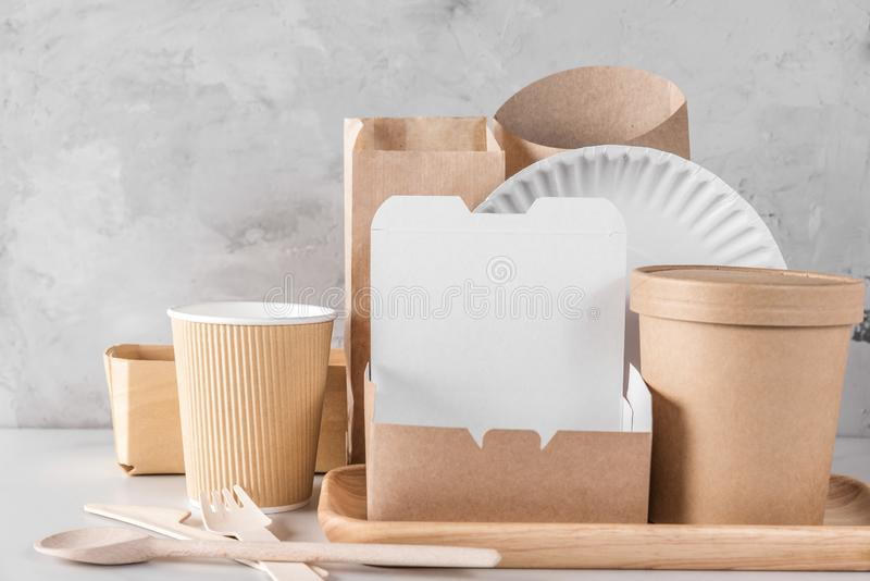 Eco friendly disposable tableware. Paper cups, dishes, fast food containers and bamboo wooden cutlery. Recycling concept royalty free stock image