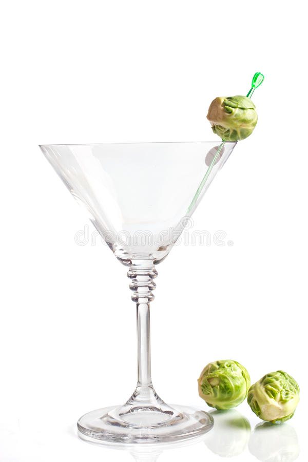 Eco friendly juice. Martini glass with brussel sprout buds royalty free stock photo