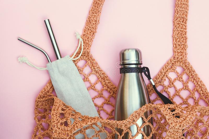 String bag with reusable water bottle and metal straws, go green and use no single use plastic. Eco-friendly lifestyle, string bag with reusable water bottle and stock images