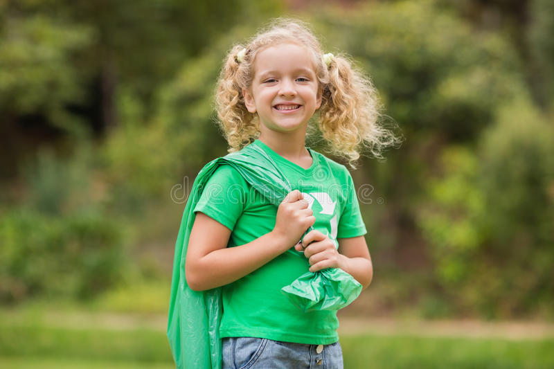 Eco friendly little girl smiling to camera royalty free stock images