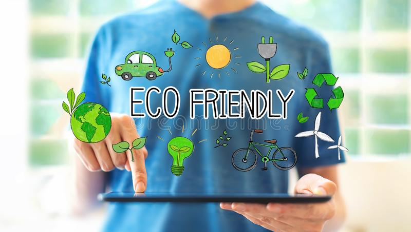 Eco friendly with man using a tablet stock image
