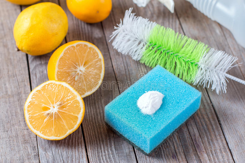 Eco-friendly natural cleaners baking soda, lemon and cloth on wooden table Homemade green cleaning royalty free stock photo