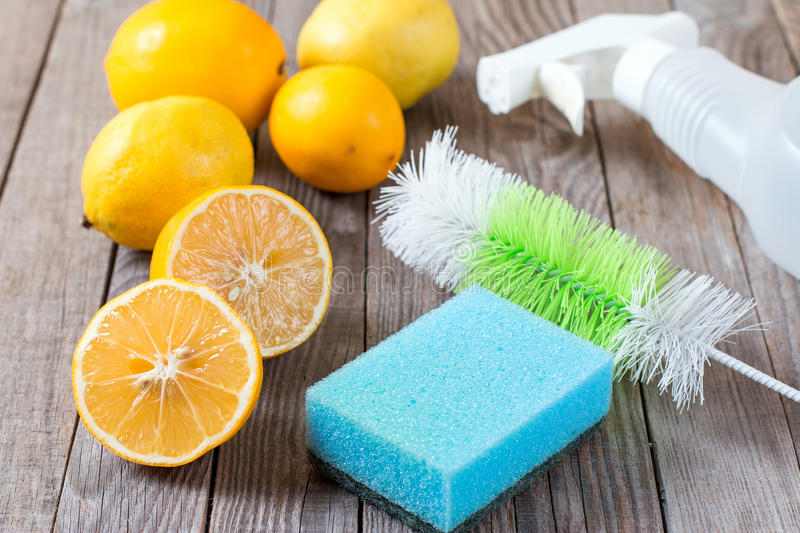 Eco-friendly natural cleaners baking soda, lemon and cloth on wooden table stock photos