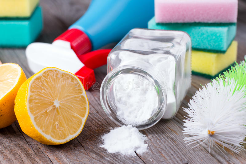 Eco-friendly natural cleaners. Baking soda, salt, lemon and cloth royalty free stock photos