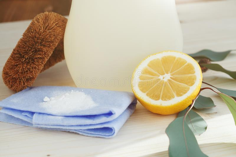 Eco-friendly natural cleaning products. And eucalyptus .branch on wooden kitchen table royalty free stock photography
