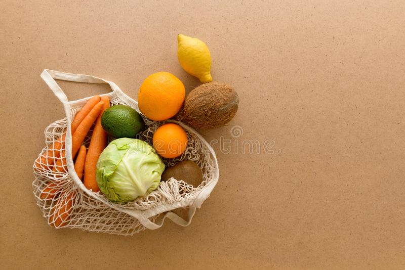 Eco friendly reusable mesh string knitted shopping bag with fruits and vegetables, zero waste royalty free stock photography