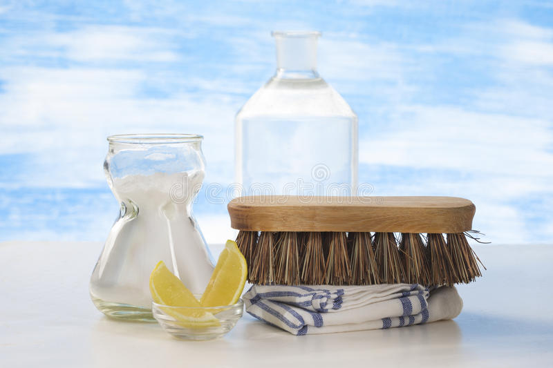 Eco-friendly sodium bicarbonate and brush as a cleaning tool. Eco-friendly natural cleaners Vinegar, baking soda, salt, lemon and cloth stock photo