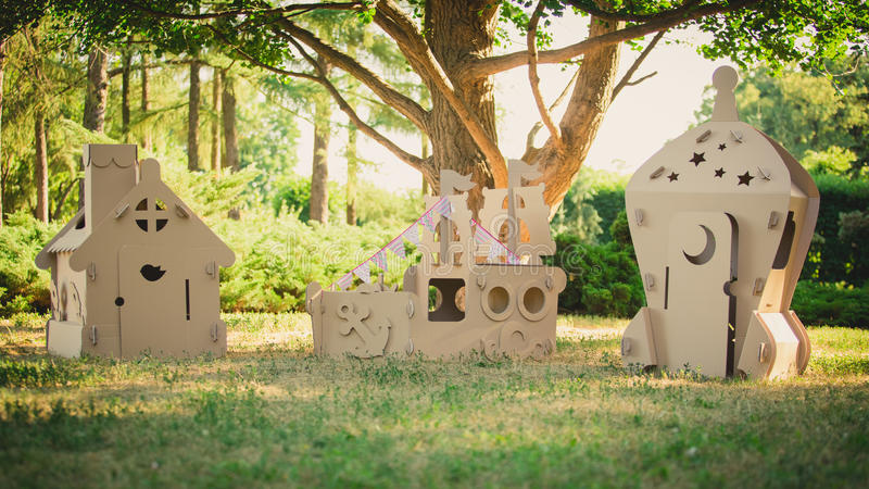 Eco-friendly toys made of cardboard ship, house and spaceship. Eco-friendly toys made of cardboard ship, a house and a spaceship. Summer day. Eco concept royalty free stock photos