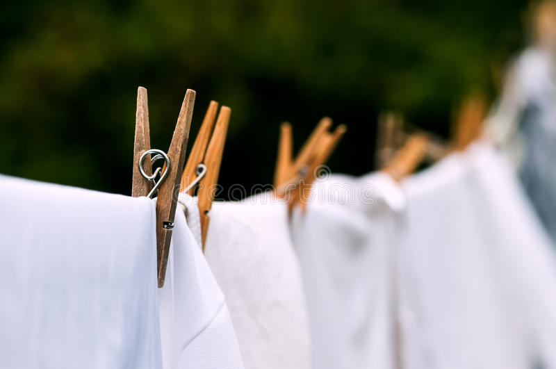 Eco-friendly washing line white laundry drying outdoors stock photos