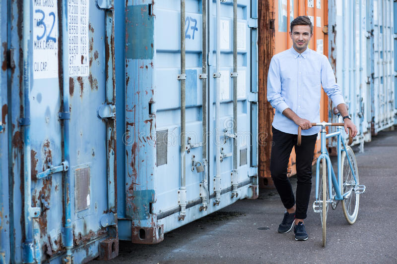 Eco-friendly way to get to work. Young man and eco-friendly way to get to work stock images