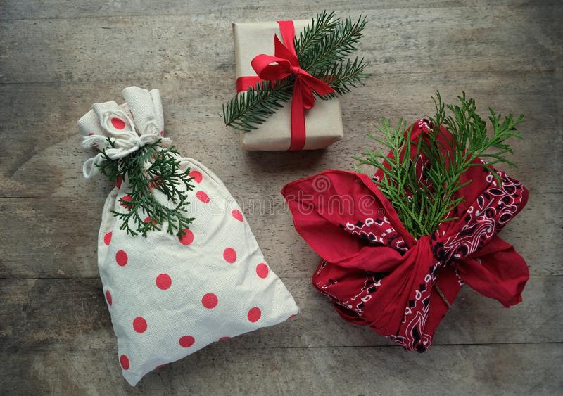 Eco Friendly way to Gift Wrap for Christmas. Xmas gift box in craft paper, reusable texile fabric wrapping and drawstring canvas stock image