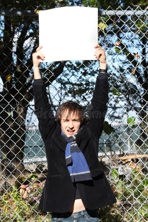 Eco-guy. Environmental series, man holding a sign royalty free stock photography