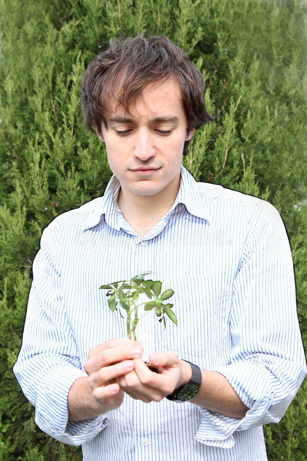 Eco-guy. Environmental series, man holding new growth royalty free stock photography