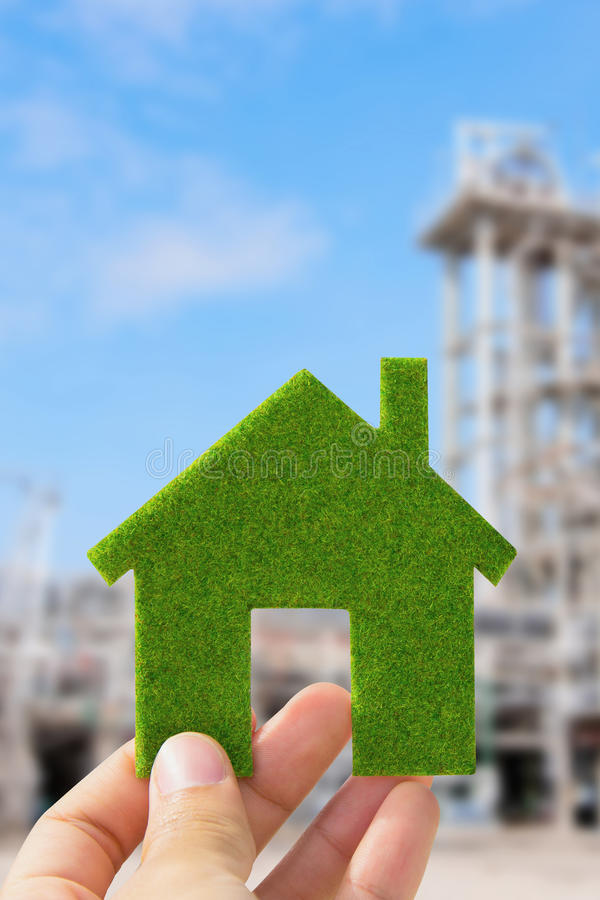 Eco house icon. Hand holding eco house icon, save energy concept royalty free stock photography