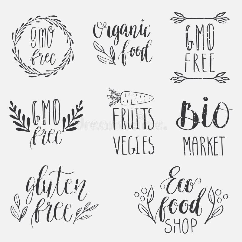 Eco natur, strikt vegetarian, bio matlogoer Handskriven bokstäver Vektorbeståndsdelar för etiketter, logoer, emblem, klistermärke stock illustrationer