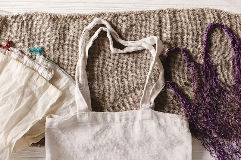eco natural reusable bags for shopping, flat lay on rustic background. sustainable lifestyle concept. zero waste. plastic free stock photo