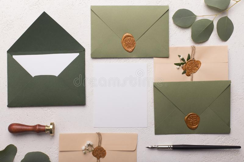 Eco paper envelopes with love letters or invitation cards. Wedding flat lay. Eco paper envelopes with love letters or invitation cards on white background stock photo