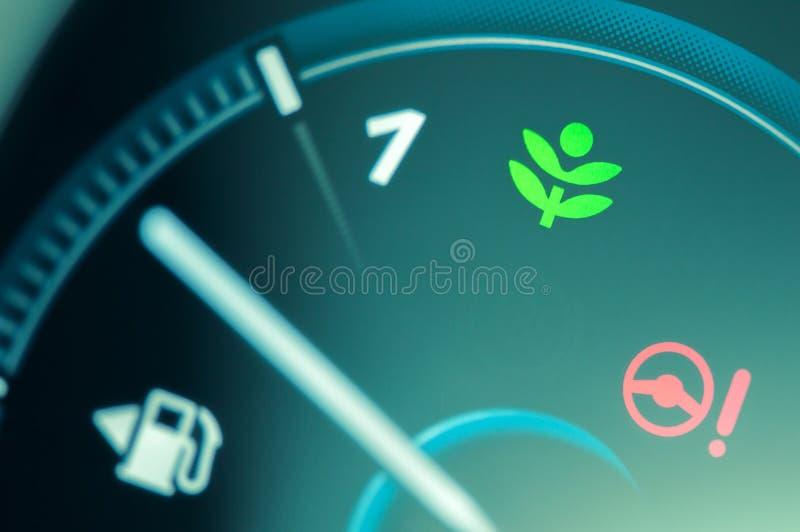 Eco przejażdżki światła ikona na samochodowej desce rozdzielczej fotografia royalty free