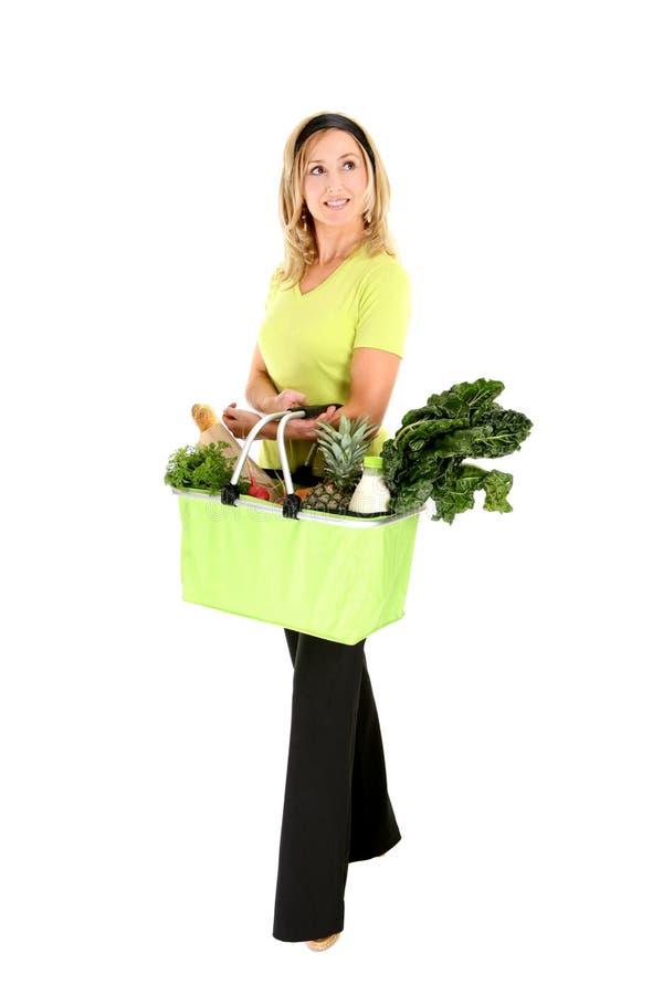 Eco shopper looking sideways stock photography
