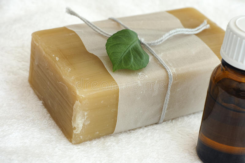 Eco soap bar and essential aroma oil stock photos