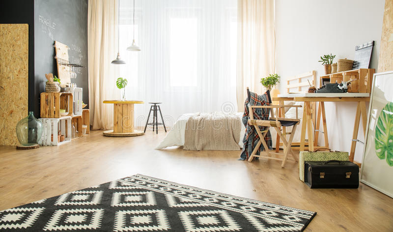 Eco style apartment with wooden furniture stock photo