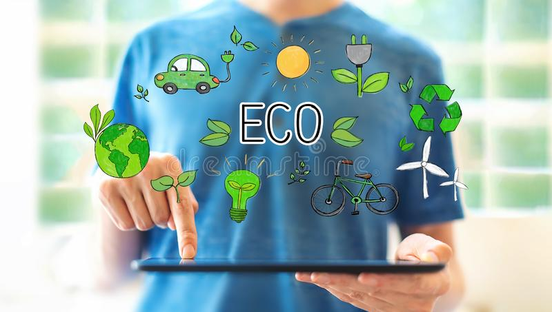 Eco theme with man using a tablet stock images
