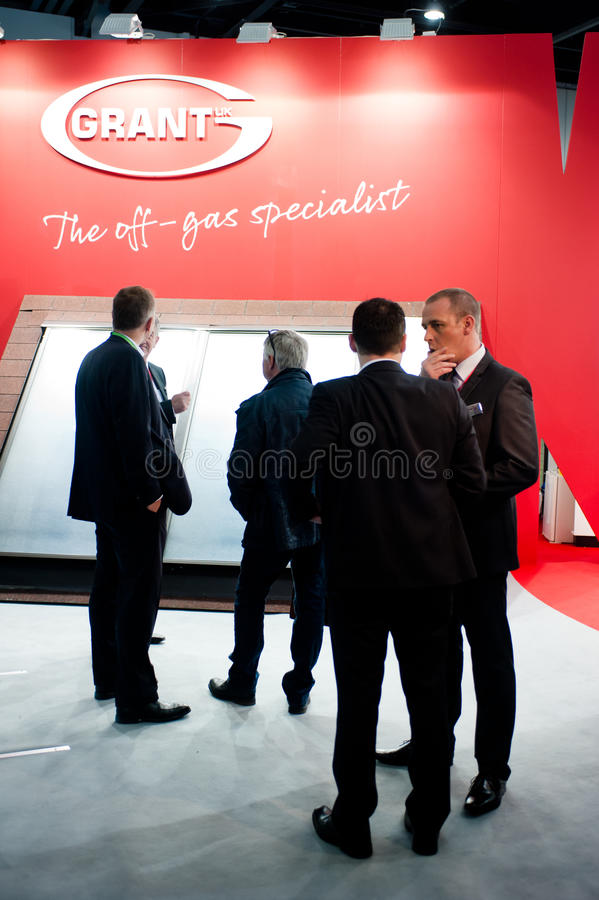 Businessmen Discussing Business At An Energy Fair Editorial Stock Photo