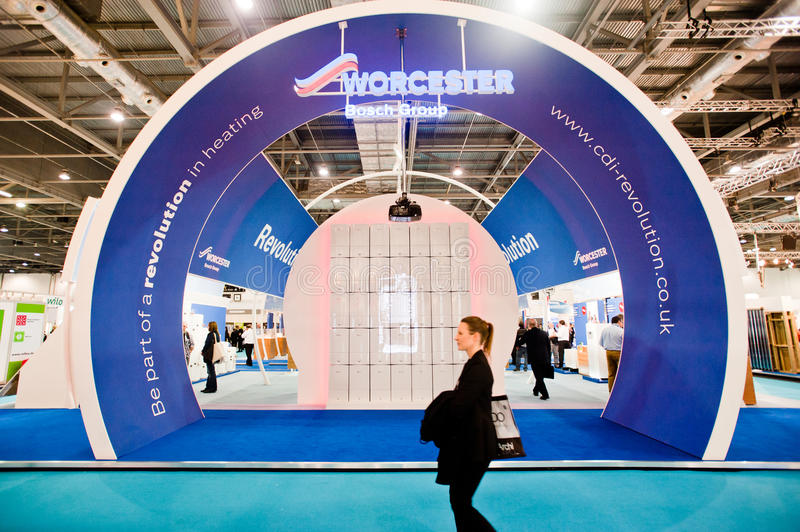 A Visitor Walk Past An Exhibitor Stand Editorial Stock Photo
