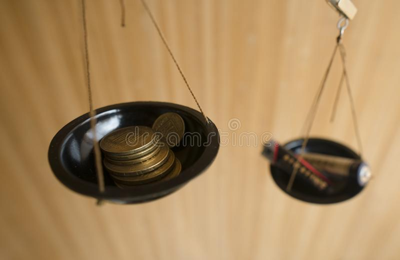 Ecologic concept. Money and batteries in the libra. stock image