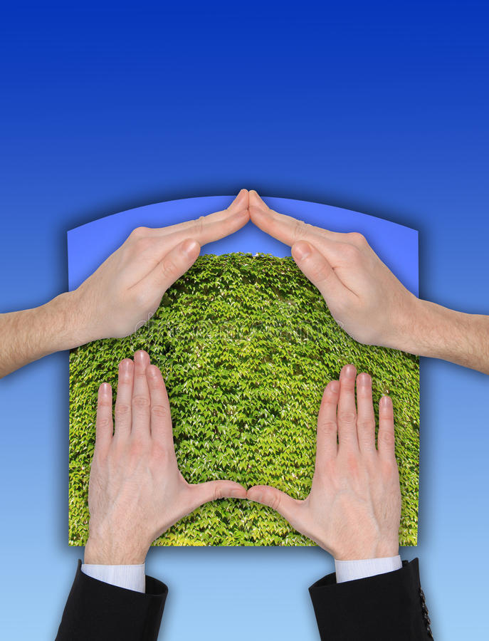 Ecologic Hand Home Gesture on the blue Sky stock images