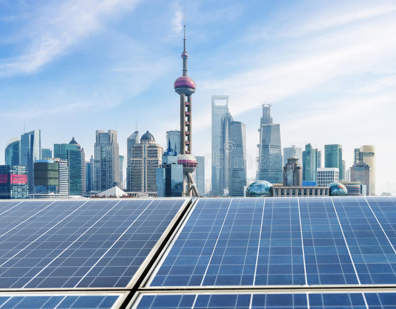 Ecological energy renewable solar panels and the bund of Shanghai skyline stock images