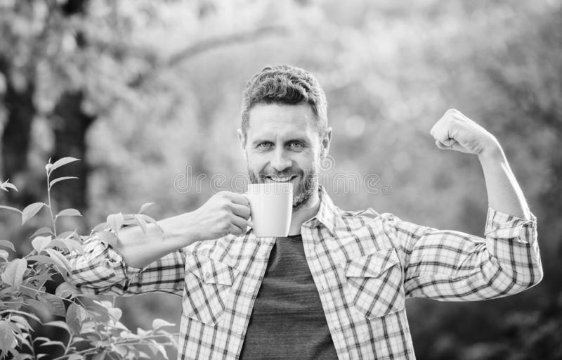 Ecological life for man. man in green forest. happy man with cup of tea. morning coffee. healthy lifestyle. nature and stock photo