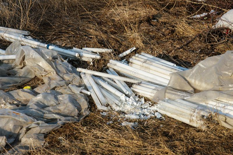 Ecological problem, disaster. Criminal disposal of fluorescent mercury lamps, E-waste. Environmental pollution. Ecological crime. Dirty broken fluorescent stock images