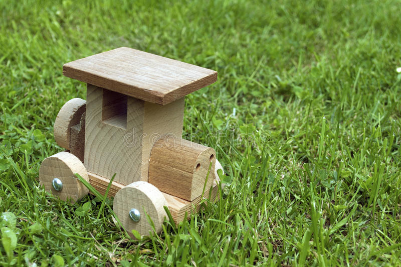 Ecological wooden car in grass