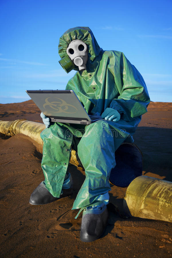Ecologist scientist in ecological disaster zone. Ecologist scientist collects data at the point of ecological disaster royalty free stock images