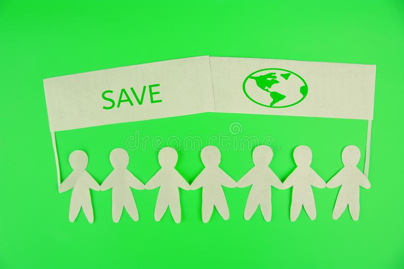 Ecology concept. paper people holding banners save the planet. Ecology concept. paper people holding banners royalty free stock image