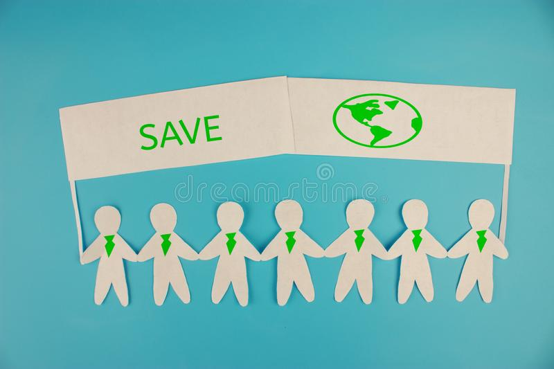 Ecology concept. paper people holding banners save the planet. Ecology concept. paper people holding banners stock photos