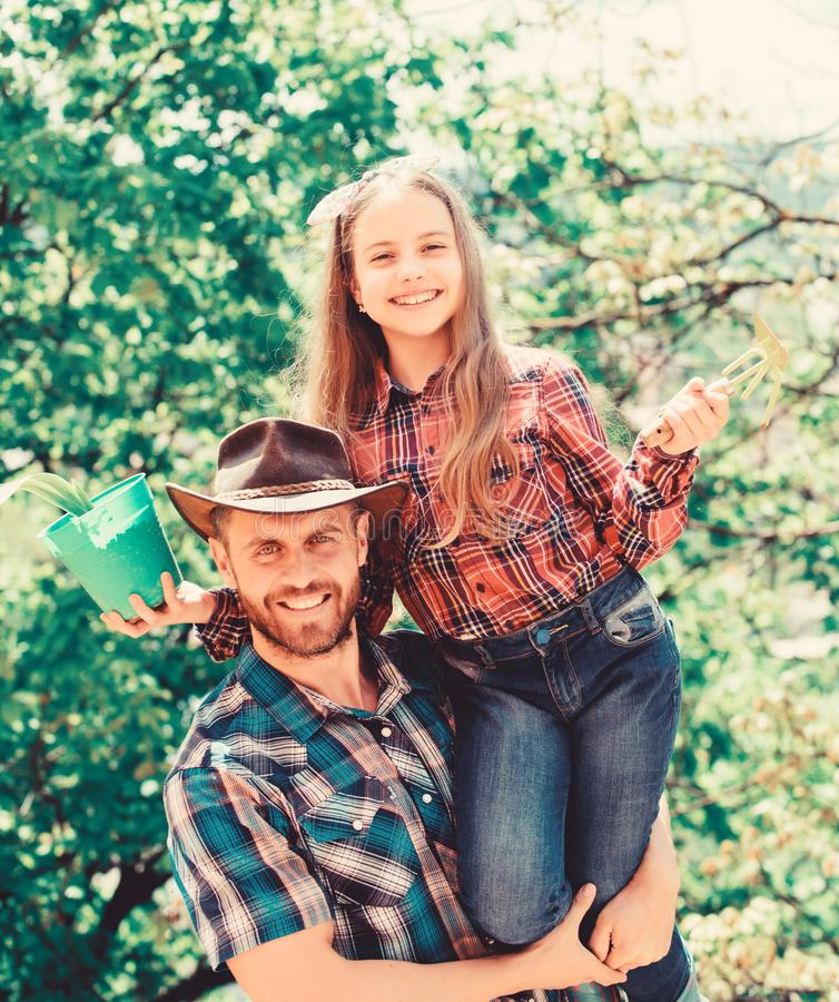 Ecology environment. soils and fertilizers. spring village country. family farm. agriculture. little girl happy man dad stock image